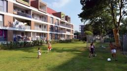 Kinder spielen auf einem Rasen vor einem neu gestalteten Gebäude Fußball